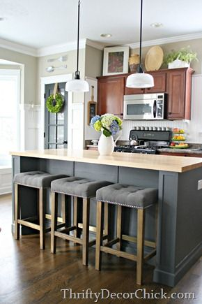 DIY Kitchen Island Remodel - several years in the making! But the final product was totally worth the work! Complete with cook book storage, a custom wine rack and DIY cushiony stools.