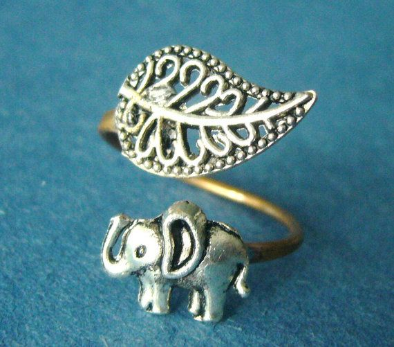Hey, I found this really awesome Etsy listing at https://www.etsy.com/listing/117825151/silver-elephant-ring-with-a-leaf-wrap
