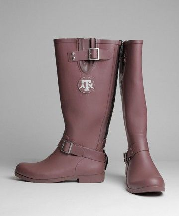 This stylish rubber boots are perfect for any rainy day. Made of maroon rubber the boots have devorative straps and block ATM medalions thats face outward. The back has a full length zipper for easy on and off wearability. The bottoms have a grippy sole to prevent slipping and the insides are lined with black felt.