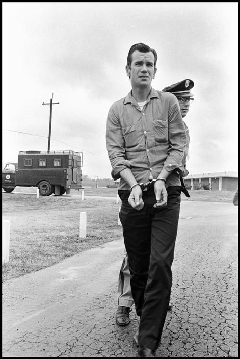 by Danny Lyon Entering Prison, Huntsville Texas State Penitentiary, 1968. From Conversations with the Dead. Diagnostic Center is a processing for inmates entering prison. Men arrive there from county...