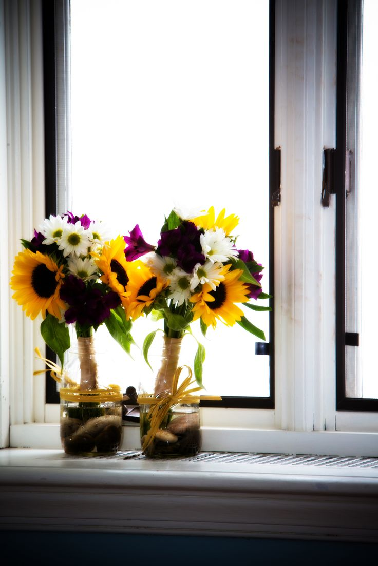 Bridesmaids flowers- Sunflowers, daisies, and purple alstroemeria