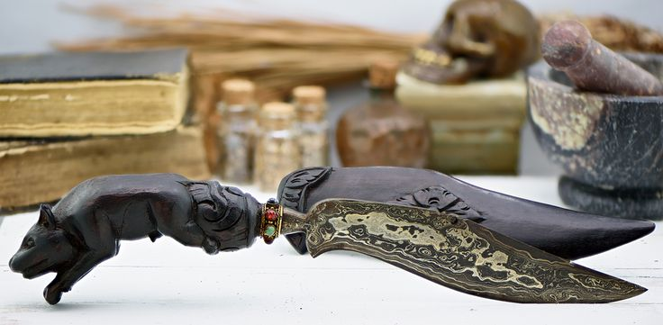 """This is certainly one of the darker artifacts from the Tula Vo estate.  A blade of transformation and change this amulet holds a dark and real power of transformation.  This binding was forged through a ritual known as """"Wolf Blood"""".  The blade reveals the presence of supernatural blood and in the hands of someone with supernatural blood it will bring it to the surface.  Any supernatural blood you have will activate the paranormal gifts and abilities which reside within you.  Through..."""
