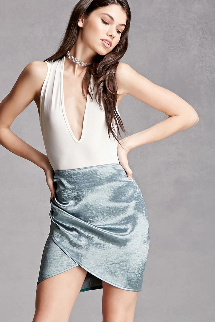 A crinkled satin mini skirt featuring a tulip hem, a ruched side, and an exposed high-polish back zipper. This is an independent brand and not a Forever 21 branded item.