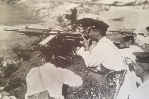 georgy-konstantinovich-zhukov:  Known as the Special Naval Landing Force, a small contingent of Japanese marines were present on Guadalcanal during the right for the island in late 1942 through early 1943. Well trained and with a strong sense of élan, the SNLF was one of Japan's more capable military formations during World War II. This group, immaculately dressed in their white uniforms and seemingly well positioned are probably either training, or posing for a picture away from the…