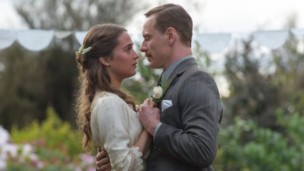 Michael Fassbender stars as Tom Sherbourne and Alicia Vikander as his wife Isabel in <i>The Light Between Oceans</i>, ...