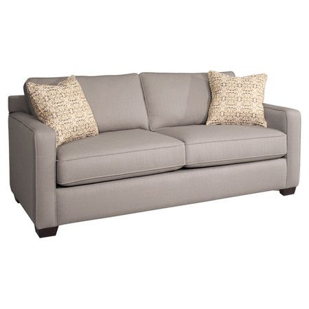showcasing track arms and a wood frame this classic sofa adds a lovely touch to
