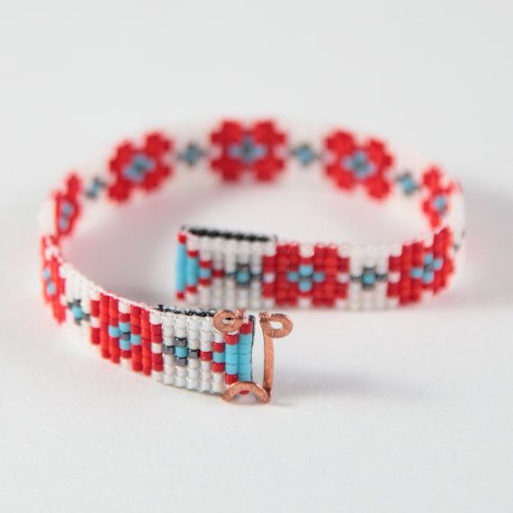 This Red Flower Bead Loom bracelet was inspired by all the beautiful Native and Latin American patterns I see around me in Albuquerque, New Mexico. As with all my pieces, Ive created it on a bead loom with great care and attention to detail. IMPORTANT NOTE: This bracelet measures approximately 6.75 long. Please measure your wrist carefully before order placement, to ensure a proper fit. If 6.75 is not the correct size for you, please contact me for options. The beads used in this piece are…