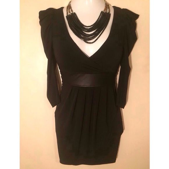 """Arden B black wrap dress Arden B black wrap dress with faux leather waistband and strap between shoulder blades in back. This mannequin has a 36"""" bust, so that should give you an idea how the v-neck might fit accordingly. Size is XS. Not interested in trades. Arden B Dresses"""