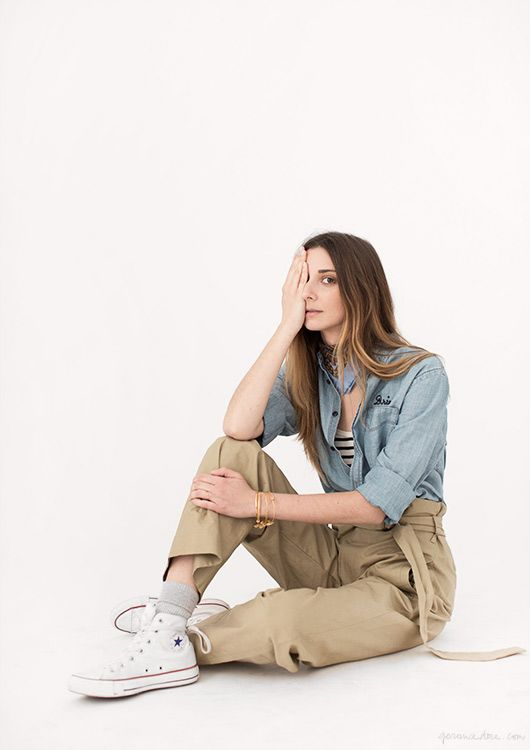 Her pose is odd, but I love the chambray, bandana, khakis and white converse together. / Garance Dore