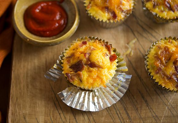 Breakfast cupcakes with eggs and bacon.  Muffin liners would be nice but aren't necessary.  The hashbrowns will cook down after 40 minutes- so use them all.  I added onions to the cheese/milk mixture (5 eggs / cup or so of milk and LOTS of cheese).  Baked the whole thing for about 15 minutes. YUM