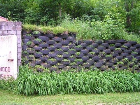 Recycled tire retaining wall