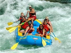 Whitewater rafting down the wild Snake River in Jackson Hole, Wyoming near the breathtaking Grand Teton National Park and the intriguing Yellowstone National Park.