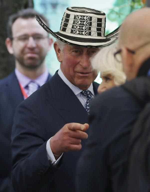 "Prince Charles sports a typical Colombian hat known as a ""sombrero vueltiao,"" as he tours an organic fair with his wife Camilla, the Duchess of Cornwall, in Bogota, Colombia, Wednesday, Oct. 29, 2014"
