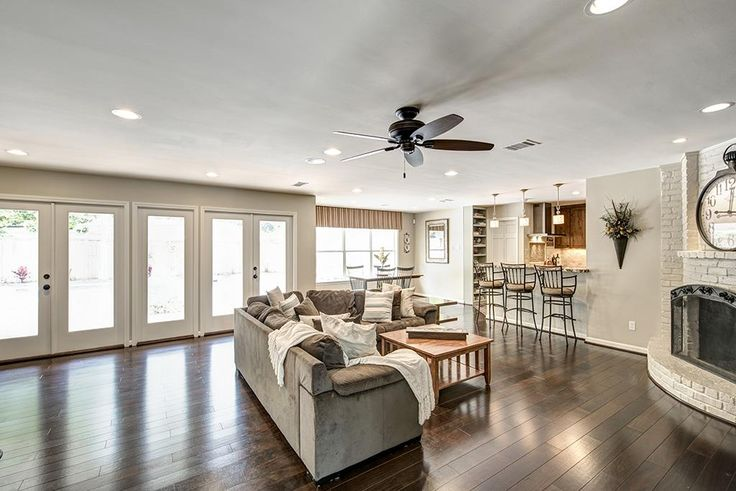 13403 Barryknoll Lane Houston, TX 77079: Photo Family room has hardwoods throughout, recessed lights, french doors leading to tropical pool/patio area and a wonderful fireplace.
