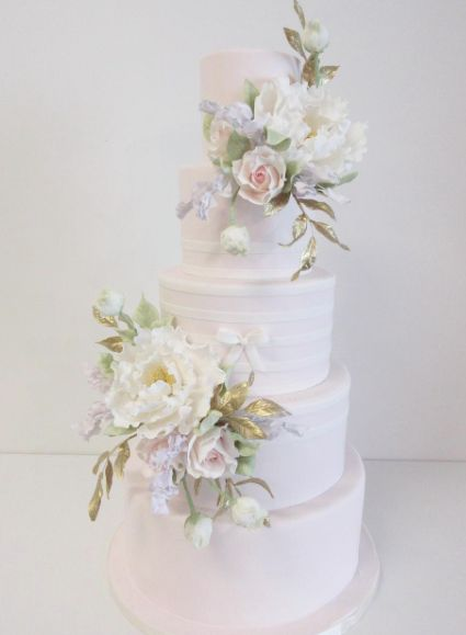 Featured Cake: A. Elizabeth Cakes; Stunning five tier white wedding cake with chic flowers; Featured Cake: A. Elizabeth Cakes