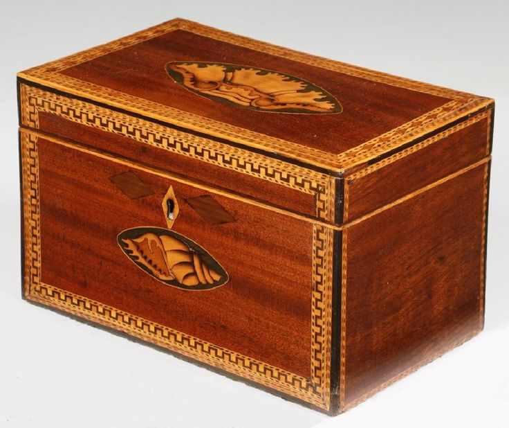 """English Early 19th c. Mahogany Tea Caddy with Satin Wood Conch Shell Decoration, crossbanded edges and satinwood escutcheon (no key), two foil lined interior compartments with single crossbanded lid, 5"""" high, 8 1/4"""" x 5""""."""