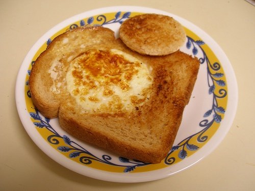 Eggy-In-A-Basket. cut a hole in the middle with the top of a cup + butter bread + put on frying pan + put an egg inside = yum