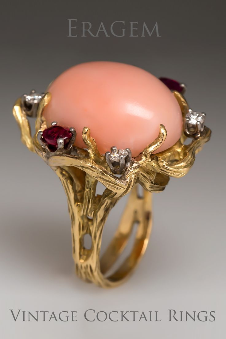 A gorgeous retro vintage cocktail ring featuring coral rubies and diamonds in 18k yellow gold