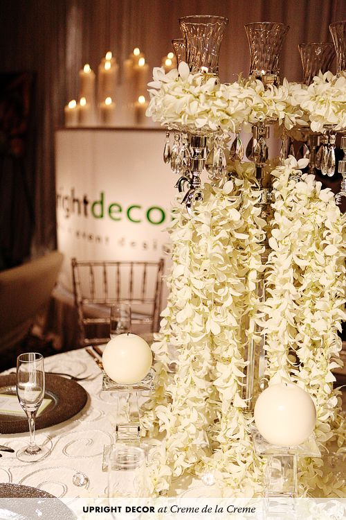 white centerpieces  garlands of orchids on candelabra