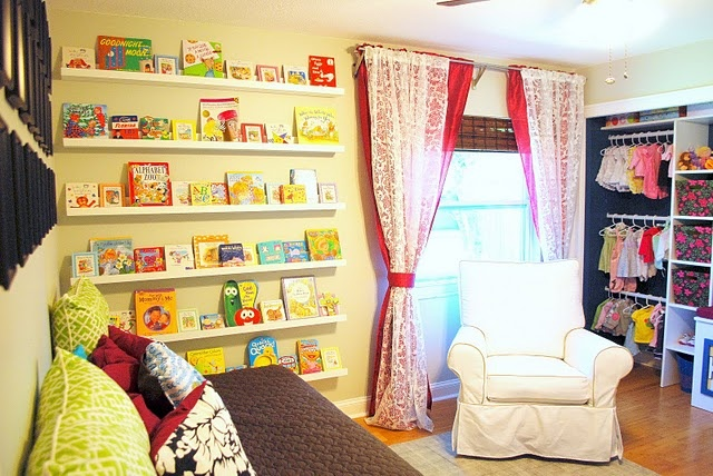 Love this wall of books...cute for playroom?!