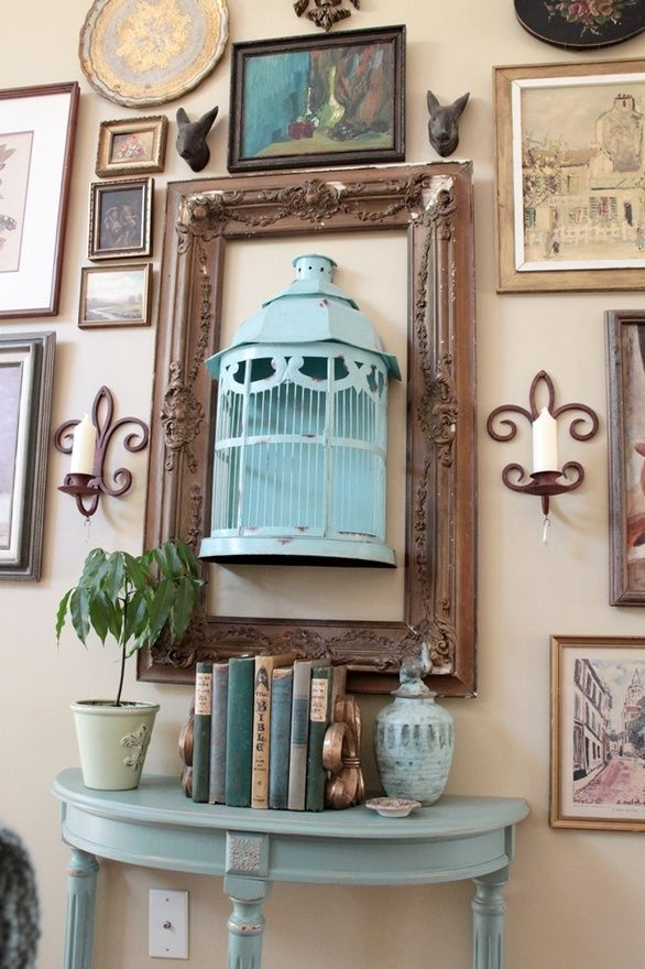Create an eclectic gallery wall display. via Southern Hospitality Dishfunctional Designs: Decorating With Bird Nests & Birdcages