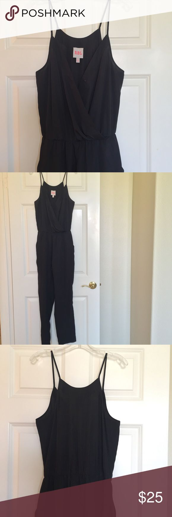 Black jumper This is a black jumper! It has pockets and has a cross cross chest line. It scrunches right at the waist making it very flattering. RBL Other