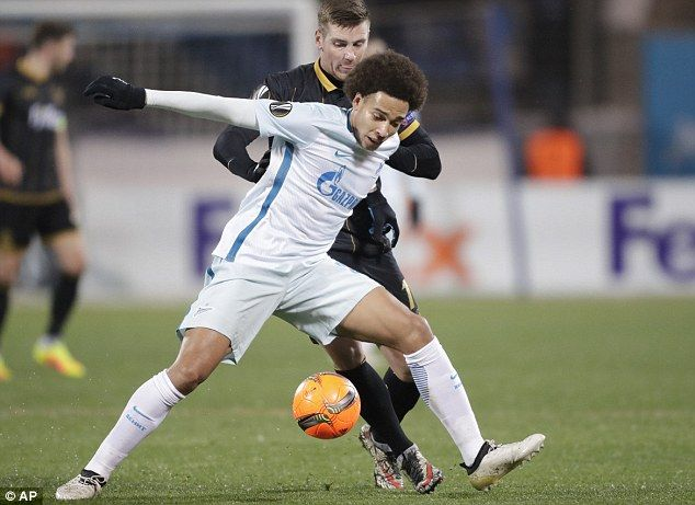 Axel Witsel, pictured in action for Zenit, is adamant he's joining Juventus in January or June