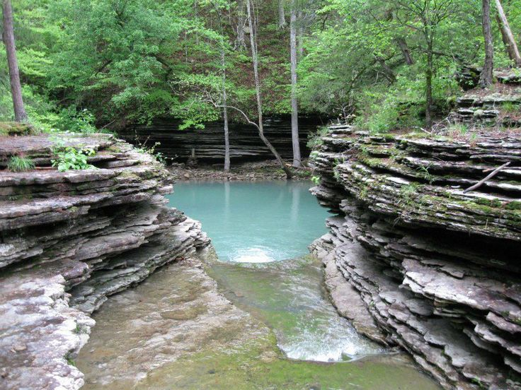 Ozark Mountains, Arkansas. One of the great camp sites and swimming holes along the Ozark Highlands Hiking Trail - this area is in the Big Piney Section of the trail. This amazing and beautiful naturally formed pool is a nice deep pool of water in the creek, surrounded by stunning rock formations... it is so gorgeous! For information on this trail go to www.ozarkhighlandstrail.com