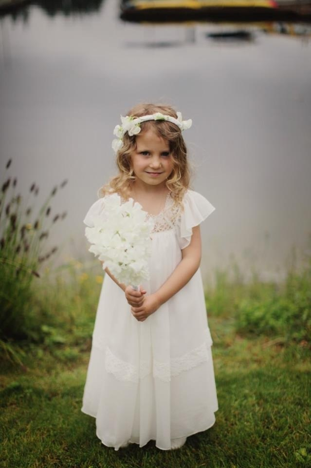 Such a pretty little flower girl. Very whimsical and simple and vintage!!! :)