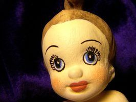 Doll faces can be simple or complex.