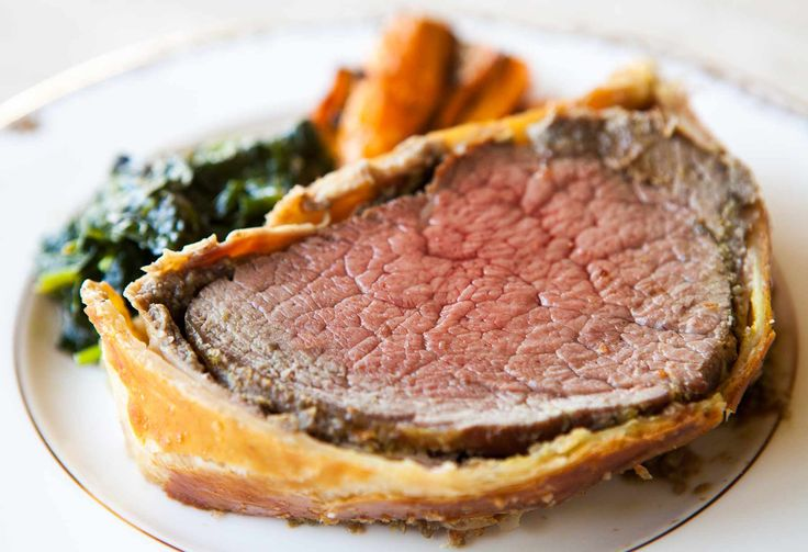 Beef Wellington ~ Beef tenderloin fillet, coated with mustard, mushroom duxelles, ham, wrapped in puff pastry and baked. Based on Gordon Ramsey Beef Wellington recipe. ~ SimplyRecipes.com