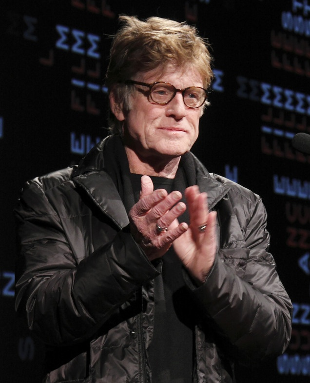 "I was there as a volunteer last night - Sundance Institute president and founder Robert Redford applauds the volunteers as he addresses the audience before the opening night premiere of ""The Queen of Versailles"" at the 2012 Sundance Film Festival in Park City, Utah on Thursday, Jan. 19, 2012. (AP Photo/Danny Moloshok)"