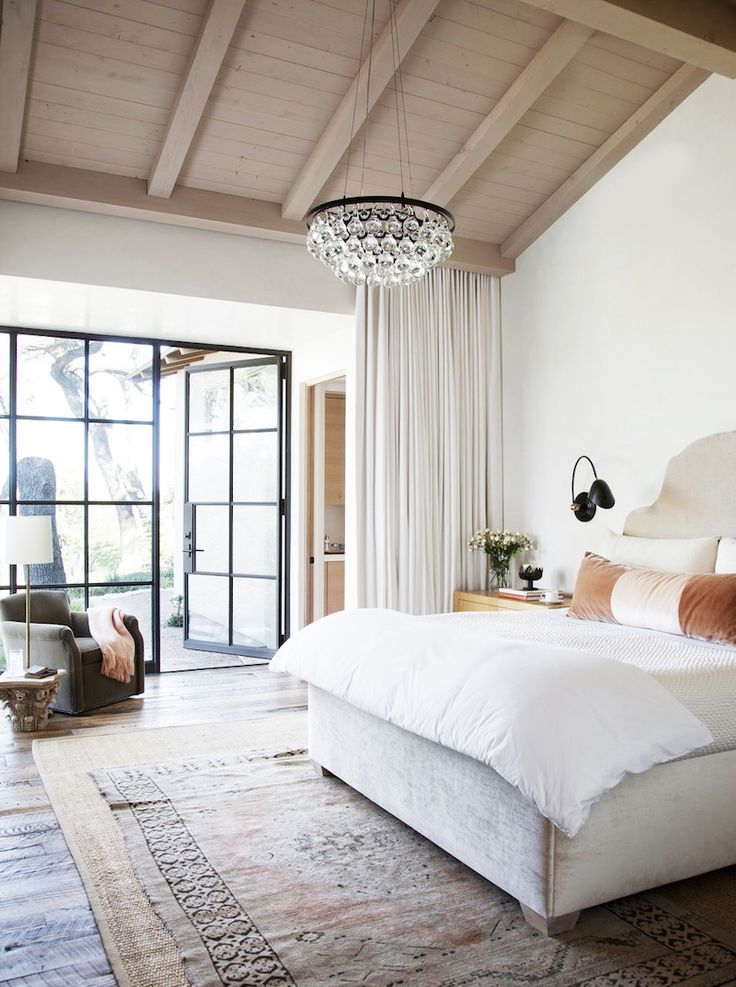 Layered Rugs in a Neutral Bedroom via One Kings Lane