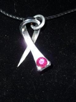 For Liz.  Cancer Ribbon Horseshoe Nail Necklace
