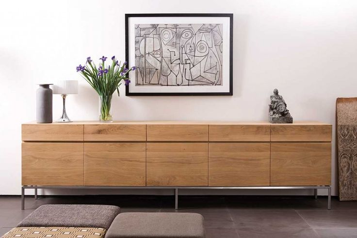 Earth tones rule in this composition, featuring #Ethnicraft's #Ligna #sideboard.