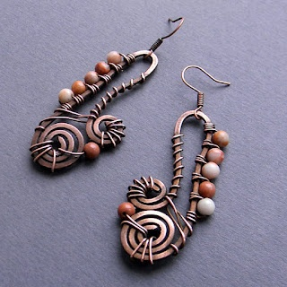 these make me think of saxophones - copper wire wrapped earrrings