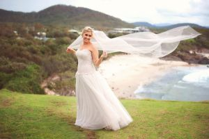 Taneeka's long Wendy Makin veil blew in the wind as they took photos on the Cabarita Beach headland with Special Memories Photography.