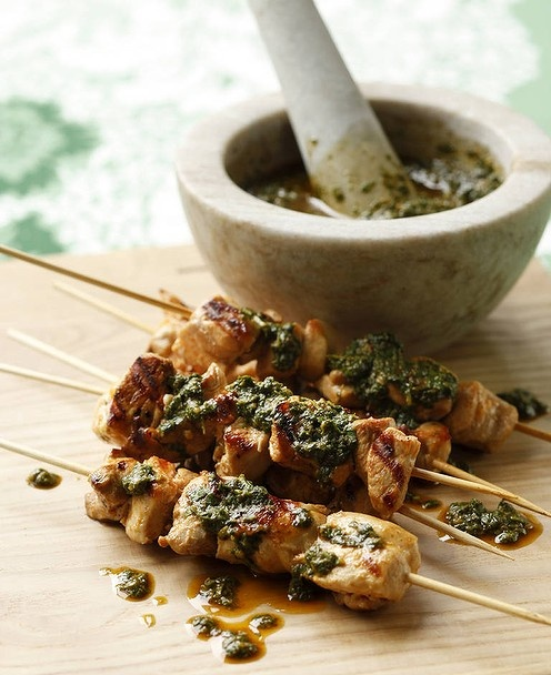 Party favourites ... Caroline Velik's chicken skewers with chermoula. Photo by Marco Del Grande. Recipe: http://www.smh.com.au/lifestyle/cuisine/poultry/recipe/marinated-chicken-skewers-with-chermoula-20111019-1m6k1.html?rand=1352074185101