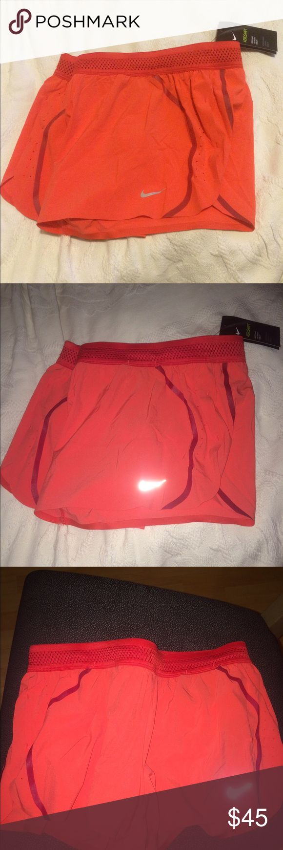 Nike shorts Nike Aeroswift shorts. Built in panty liner and two inner pockets(as shown) perfect for a key or Chapstick. Drawstring to adjust the waist. Coral color with a silver reflective Nike sign. Brand new with tags! Nike Shorts