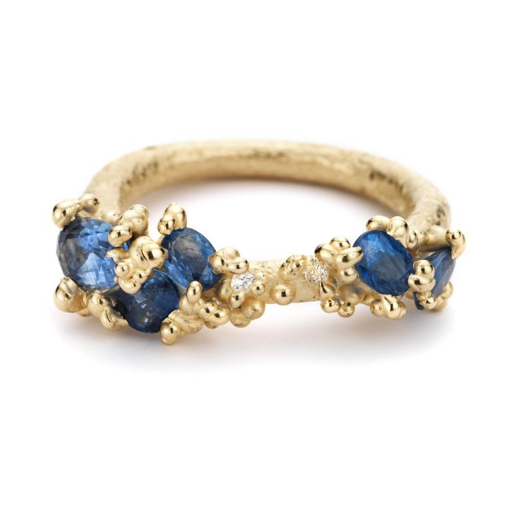 Ruth Tomlinson blue sapphire engagement ring, set in her iconic yellow gold organic style with white diamonds and beads of gold. For the truly alternative and design focussed bride. http://www.thejewelleryeditor.com/shop/product/ruth-tomlinson-sapphire-engagement-ring/ #wedding