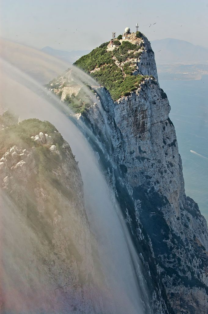 Levant cloud forming against the eastern cliffs of the Rock of Gibraltar. Located on southwestern tip of Europe on the Iberian Peninsula