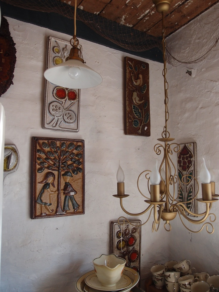 "These are Danish tile murals called ""reliefs"". I found them in an antique shop in Bornholm, a tiny island of Denmark. I own a few and love them!"