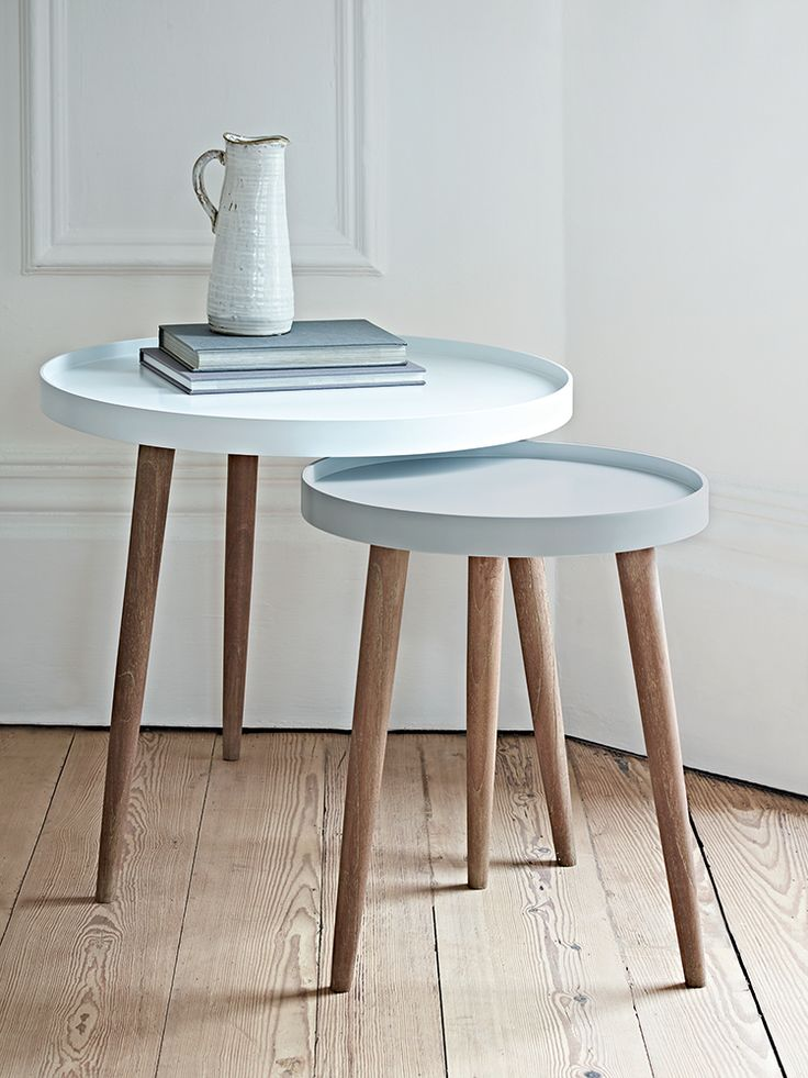 £160 With three Scandinavian style white cedar legs and a smooth modern painted lipped top, our Lina Side Tables are finished in two complimentary shades, the larger a light powder blue and the smaller a soft grey blue. Use alone as a stylish side table or nest together to make a statement in your living space. Also available in two blush shades here, and two grey colours here.