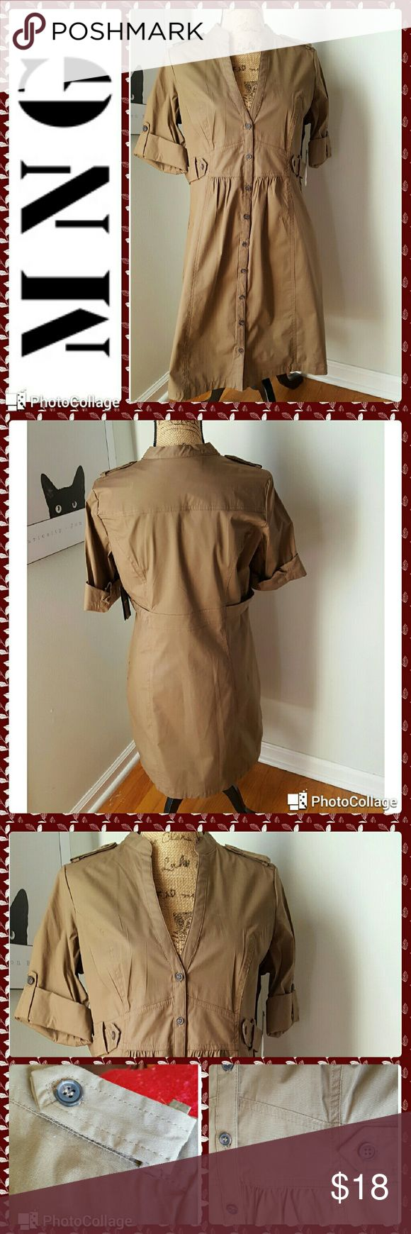 "?? NEW LISTING! NWT. MNG by Mango NWT.  MNG by Mango dress. Khaki cotton with stretch military style dress. Button down front. Short sleeves with rolled cuffs and button placket.  Half waist button plackets on each side. Button shoulder plackets.  Side slip pockets. Measurements are length 36.5"", sleeves 11"", waist 32"", bust 38"". Mango Dresses"
