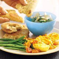 Recept - Eiercurry met naanbrood - Allerhande - Ipv tomaten een blik gepelde tomaten gebruiken