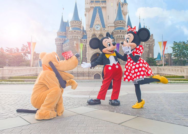 Mickey, Minnie & Pluto spending a little time together in front of Cinderella Castle at Tokyo Disneyland