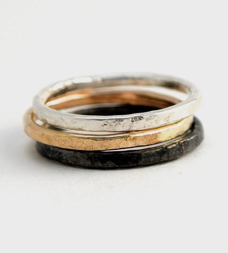 Already grouped to make a stack, this ring set includes three rings in different metals.