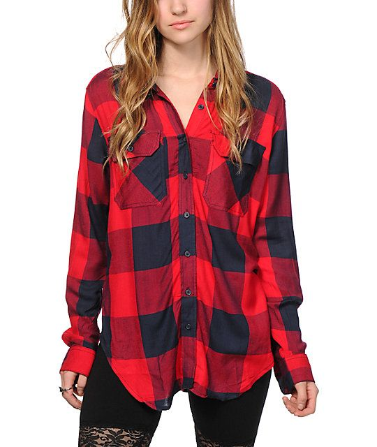 A red and navy buffalo plaid pattern covers this boyfriend fit button up  shirt that is