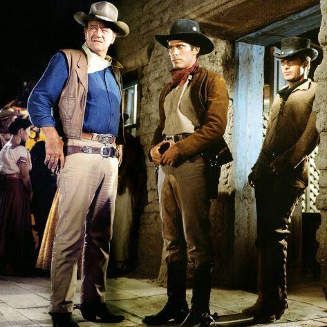 John Wayne, Christopher George y James Caan en 'El Dorado', dirigida por Howard Hawks (1967)