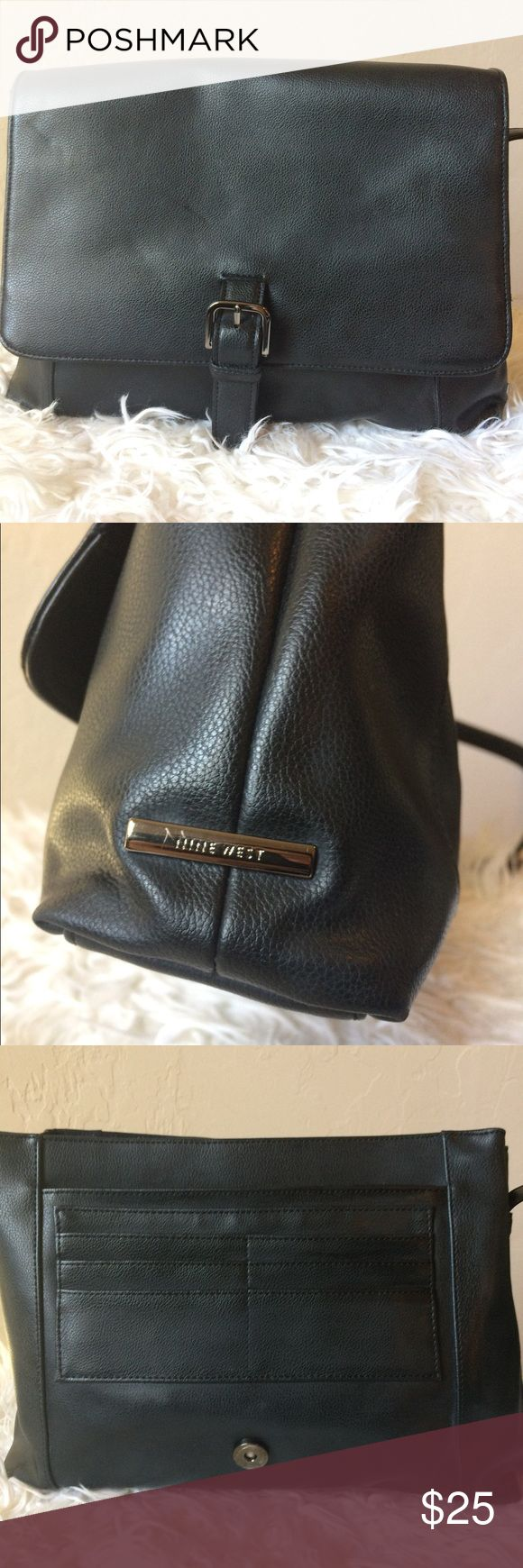 Nine West purse This beautiful, classic, black purse is great for everyday use! It has two small white scratches (pictured) which are on the inside of the strap and not noticeable. This is a must have in every girl's closet! Nine West Bags Shoulder Bags